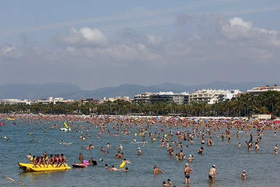 Crowded beach with pedal boats