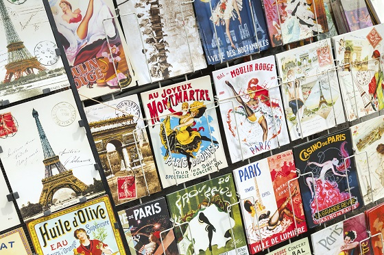 Parisian postcards on the counter of street gift shop in Paris