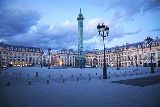 Famous Vendôme square of Paris at twilight. Sepia toned. France series