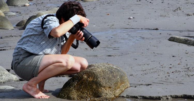 Fotógrafo en una playa. liz west (Flickr)
