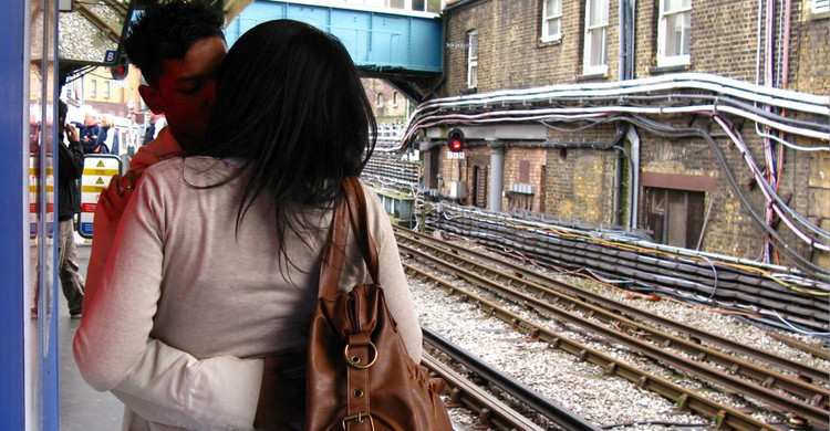 Kissing at tube station. TheeErin, Flickr